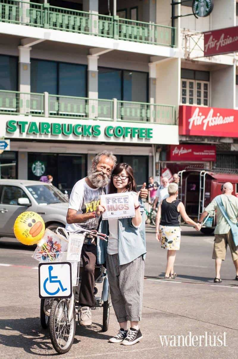 Wanderlust Tips Magazine | A homeless man and his free hugs