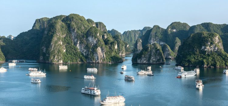 Admire the sunrise amidst the limestones in Ha Long Bay
